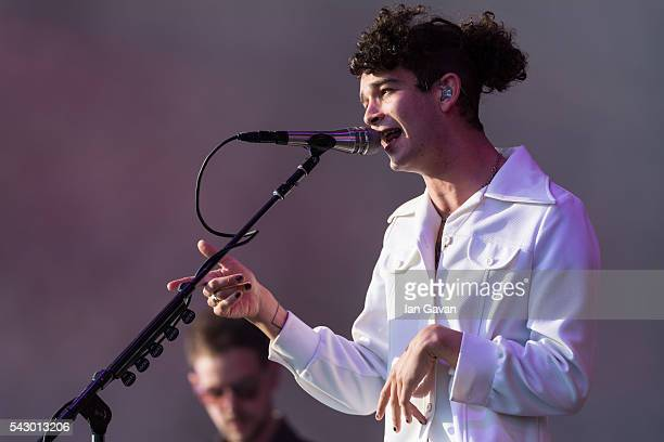 Matthew Healy of '1975' performs on The Other Stage on day 2 of the Glastonbury Festival at Worthy Farm Pilton on June 25 2016 in Glastonbury England...
