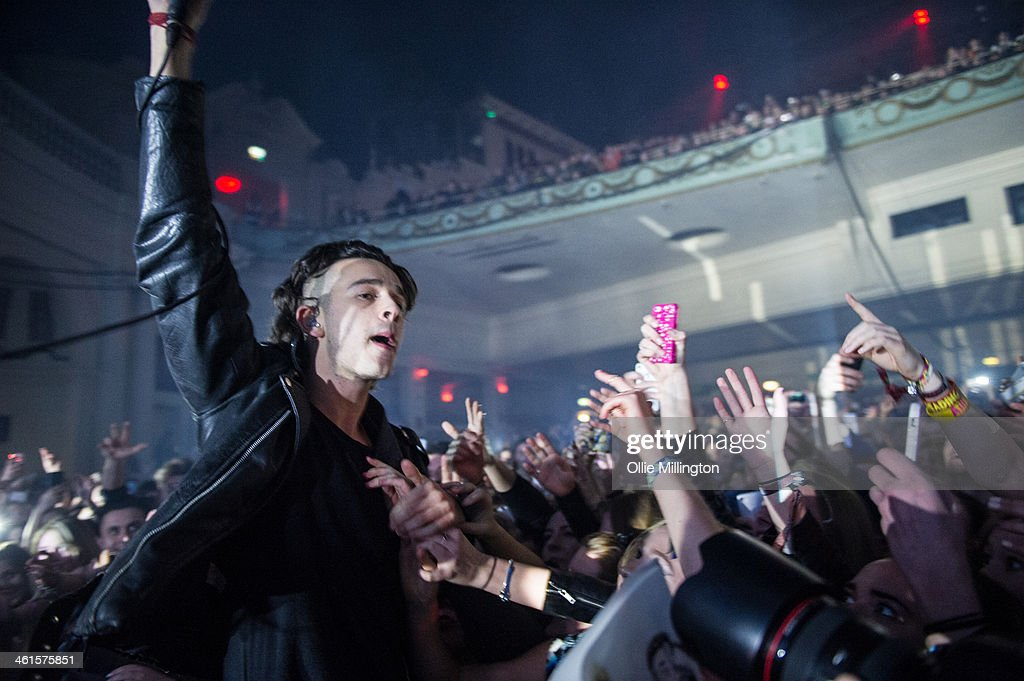Matthew Healy of The 1975 performs infront of the front row at Brixton Academy on January 9, 2014 in London, United Kingdom.