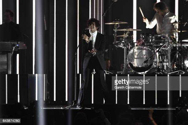 Matthew Healy performs with The 1975 on stage at The BRIT Awards 2017 at The O2 Arena on February 22 2017 in London England