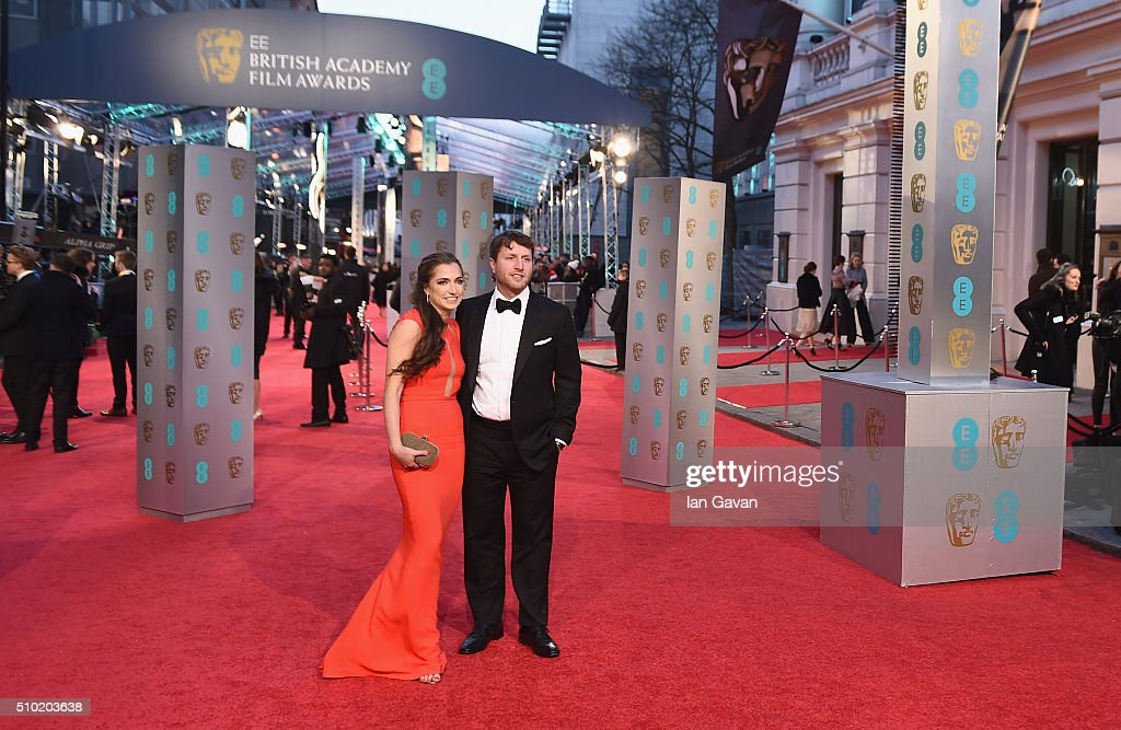 Matthew Heinemann (R) and guest attend the EE British Academy Film Awards at the Royal Opera House on February 14, 2016 in London, England.