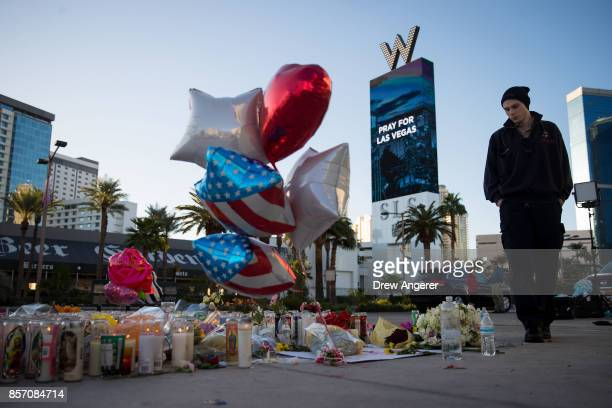 Matthew Helms who worked as a medic the night of the shooting visits a makeshift memorial for the victims of Sunday night's mass shooting on the...
