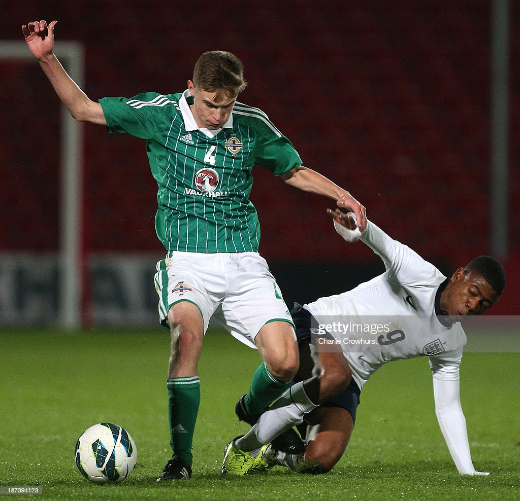 Matthew Henry of Northern Ireland skips the tackle from Jahmal Hector-Ingram of England during the Victory Shield match between England U16 and Northern Ireland U16 at Goldsands Stadium on November 08, 2013 in London, England.