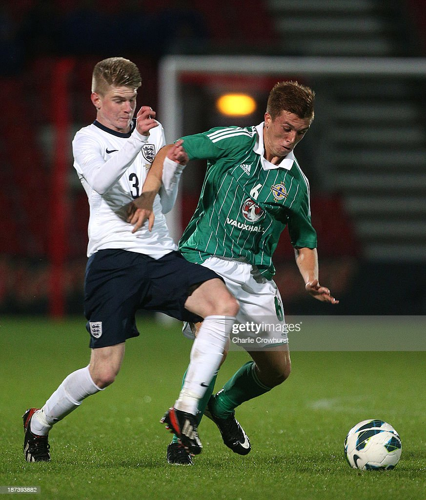 Matthew Henry (R) of Northern Ireland tries to hold off Englands Hayden Coulson during the Victory Shield match between England U16 and Northern Ireland U16 at Goldsands Stadium on November 08, 2013 in London, England.
