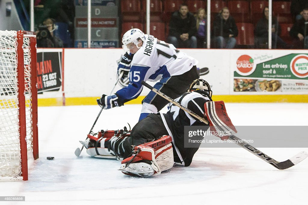Matthew Highmore #15 of the Saint John Sea Dogs puts the puck past Bo Taylor #37 of the Gatineau Olympiques on October 18, 2015 at Robert Guertin Arena in Gatineau, Quebec, Canada.