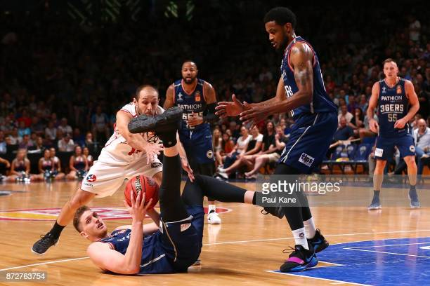 Matthew Hodgson of the 36ers dives on a loose ball against Rhys Martin of the Hawks during the round six NBL match between the Adelaide 36ers and the...