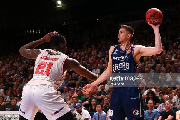Matthew Hodgson of the 36ers looks to pass the ball during the round six NBL match between the Adelaide 36ers and the Illawarra Hawks at Titanium...