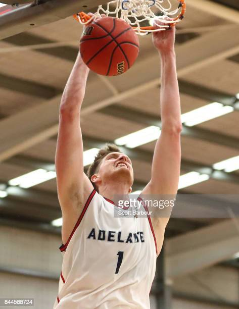Matthew Hodgson of the Adelaide 36ers dunks the ball during the 2017 NBL Blitz preseason match between the Brisbane Bullets and the Adelaide 36ers at...