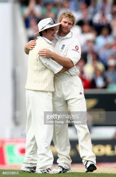 Matthew Hoggard is congratulated by England captain Andrew Strauss after capturing Mohammad Hafeez's wicket during the second day of the fourth...