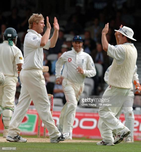 Matthew Hoggard is congratulated by England captain Andrew Strauss following the wicket of Mohammad Hafeez for 95 bowled by Matthew Hoggard and...