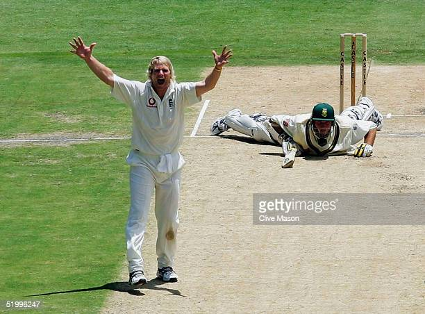 Matthew Hoggard of England appeals sucessfully for the wicket of a felled Graeme Smith of South Africa during the third day of the fourth test match...