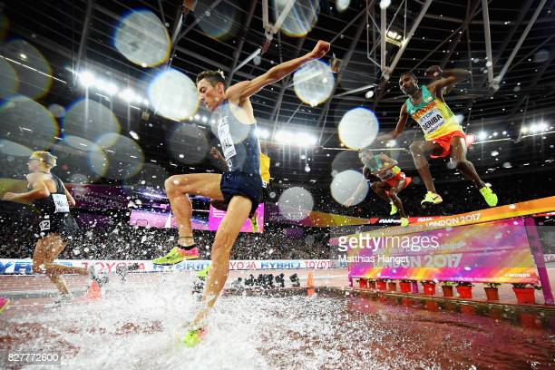 Matthew Hughes of Canada Yoann Kowal of France and Tesfaye Deriba of Ethiopia take the water jump as they compete in the Men's 3000 metres...