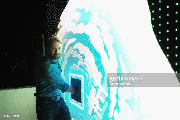 Matthew Hutchinson sticks his hand in the 'Free Hole' during the 2017 Adult Swim Upfront Party at Terminal 5 on May 17 2017 in New York City