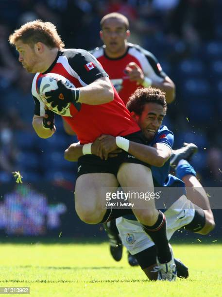 Matthew Iakopo of Samoa tackles James Buchanan of Canada during the IRB Emirates Airline Edinburgh 7's Pool match between Samoa and Canada at...