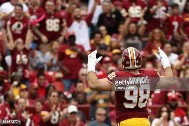 Matthew Ioannidis of the Washington Redskins celebrates a sack on quarterback Brian Hoyer of the San Francisco 49ers during the first quarter at...