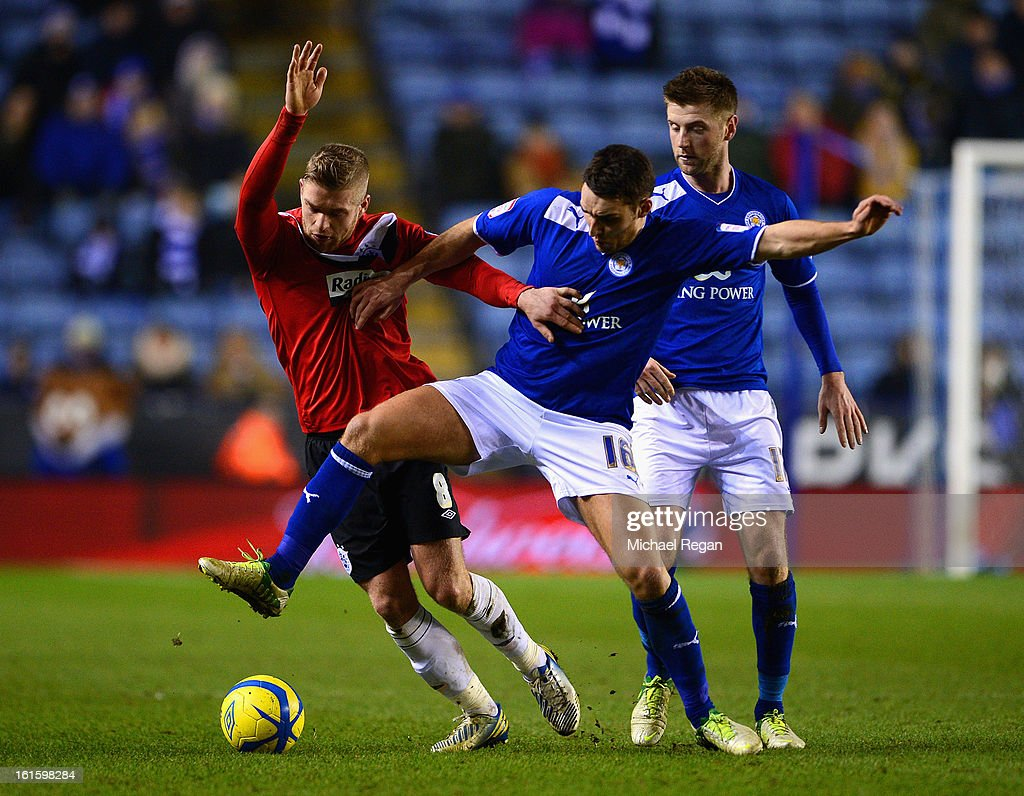 Matthew James and Paul Gallagher of Leicester in action with Adam Clayton of Huddersfield during the FA Cup Fourth Round Replay between Leicester City and Huddersfield Town at The King Power Stadium on February 12, 2013 in Leicester, England.