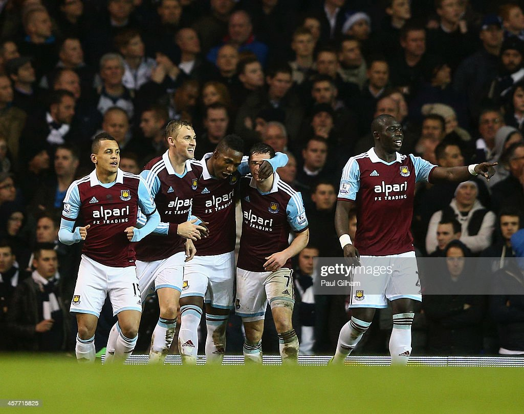 Matthew Jarvis of West Ham United (2R) celebrates with team mates as he scores their first goal during the Capital One Cup Quarter-Final match between Tottenham Hotspur and West Ham United at White Hart Lane on December 18, 2013 in London, England.