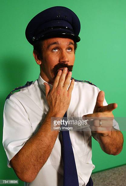 Matthew Johns of the Cronulla Sharks in character as Trent the flight steward poses for a photo during a segment on the Channel Nine Footy Show on...