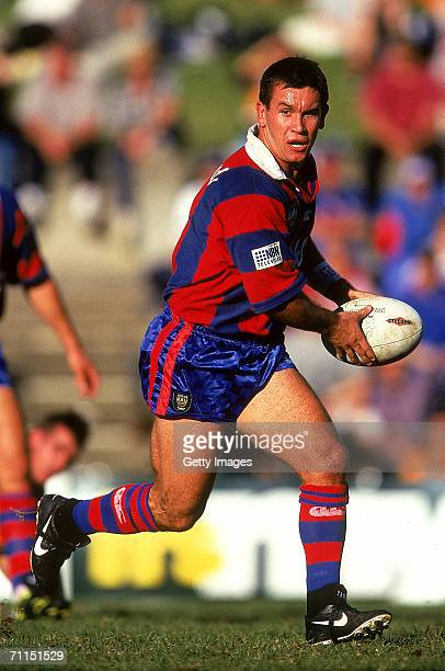 Matthew Johns of the Knights looks to offoad during a ARL match between the Balmain Tigers and the Newcastle Knights at Leichhardt Oval 1997 in...