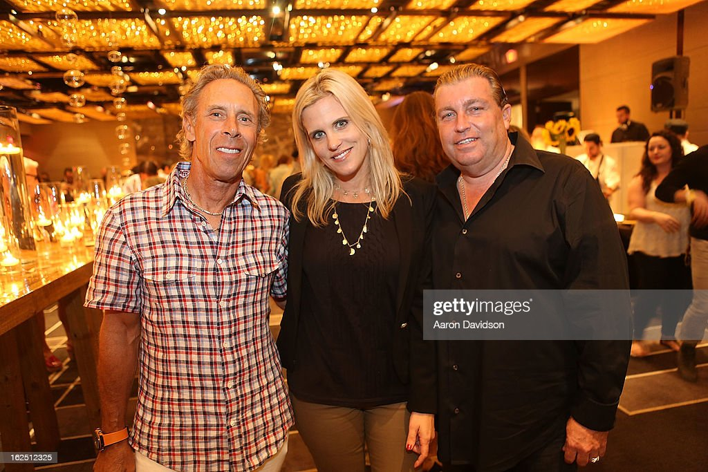 Matthew Johnson, Tricia Johnson, and Guest attend Chicken Coupe Dinner at W South Beach Hotel & Residences on February 23, 2013 in Miami Beach, Florida.