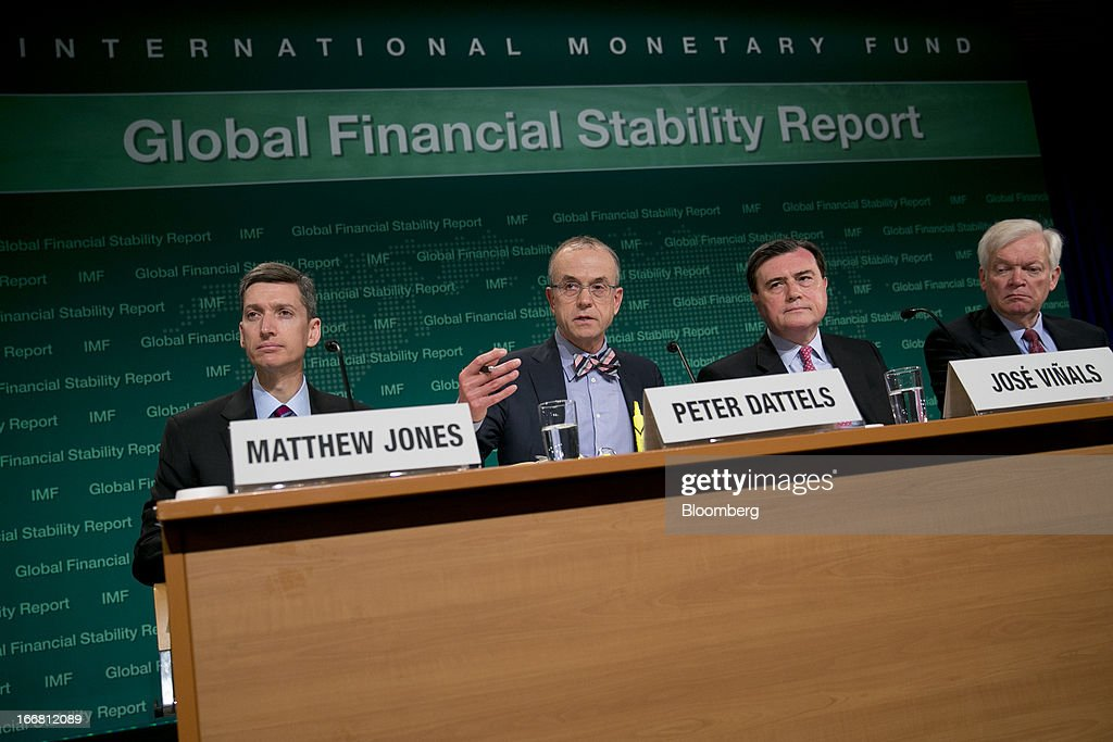 Matthew Jones, economist at the International Monetary Fund (IMF), left to right, Peter Dattels, chief of global market monitoring with the IMF, Jose Vinals, director of the capital markets department with the IMF, and Robert Sheehy, deputy director of monetary and capital markets with the IMF, hold a global financial stability report news conference in Washington, D.C., U.S., on Wednesday, April 17, 2013. As much as 20 percent of non-bank corporate debt in the weakest euro-area economies is unsustainable and may force companies to cut dividends and sell assets, dealing further blows to investor confidence, the IMF said. Photographer: Andrew Harrer/Bloomberg via Getty Images