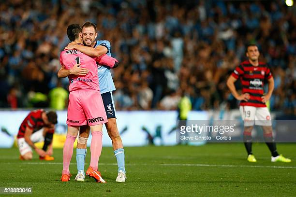 Matthew Jurman and Vedran Janjetovic of the Sydney FC celebrate after defeating the Wanderers 21 during the round 15 ALeague match between the...