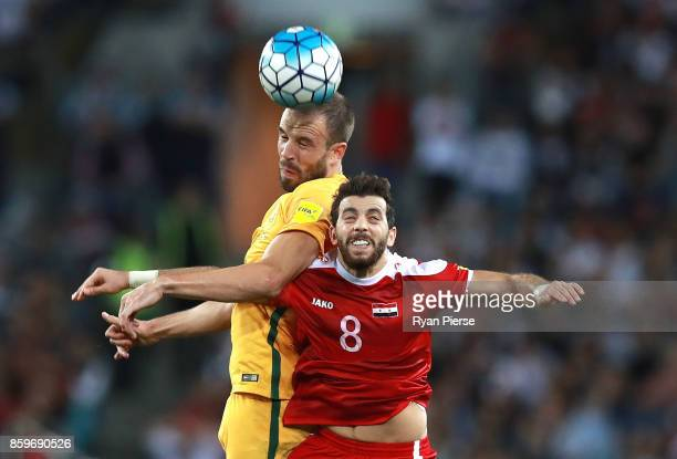 Matthew Jurman of Australia competes for the ball against Mahmoud Al Mawas of Syria during the 2018 FIFA World Cup Asian Playoff match between the...