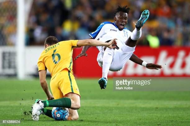 Matthew Jurman of Australia tackles Alberth Elis of Honduras during the 2018 FIFA World Cup Qualifiers Leg 2 match between the Australian Socceroos...