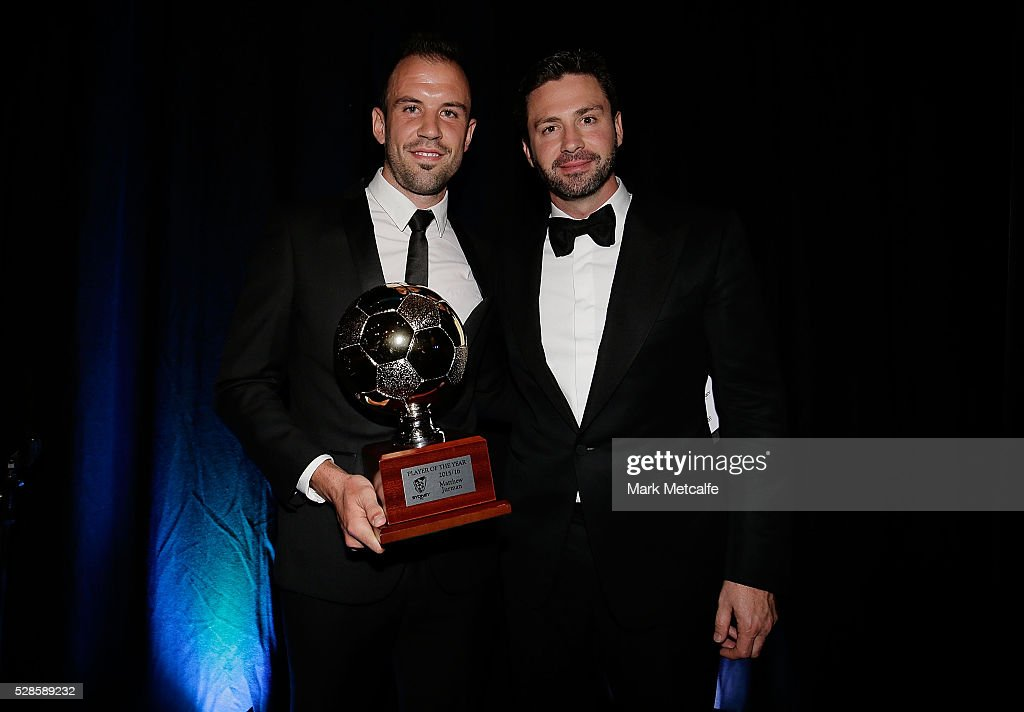 Matthew Jurman poses with the Hyundai A-League Player of the Year award next to Sydney FC Chairman Scott Barlow during the Sydney FC Sky Blue Ball at the Sydney Cricket Ground on May 6, 2016 in Sydney, Australia.