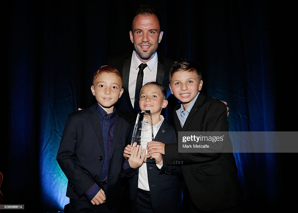Matthew Jurman poses with the Members' Player of the Year award during the Sydney FC Sky Blue Ball at the Sydney Cricket Ground on May 6, 2016 in Sydney, Australia.