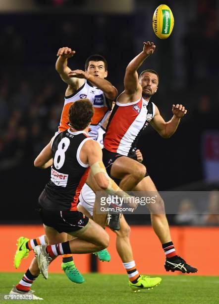 Matthew Kennedy of the Giants and Jarryn Geary of the Saints compete for a mark during the round seven AFL match between the St Kilda Saints and the...