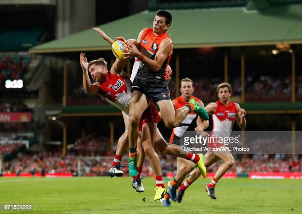 Matthew Kennedy of the Giants attempts to mark over Jake Lloyd of the Swans during the 2017 AFL round 05 match between the Sydney Swans and the GWS...