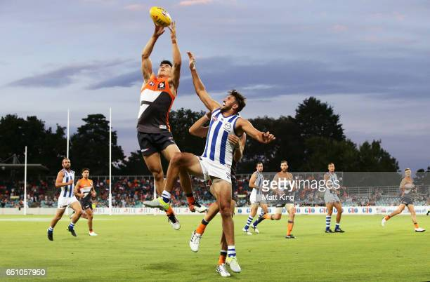 Matthew Kennedy of the Giants is challenged by Jarrad Waite of the Kangaroos during the JLT Community Series AFL match between the Greater Western...
