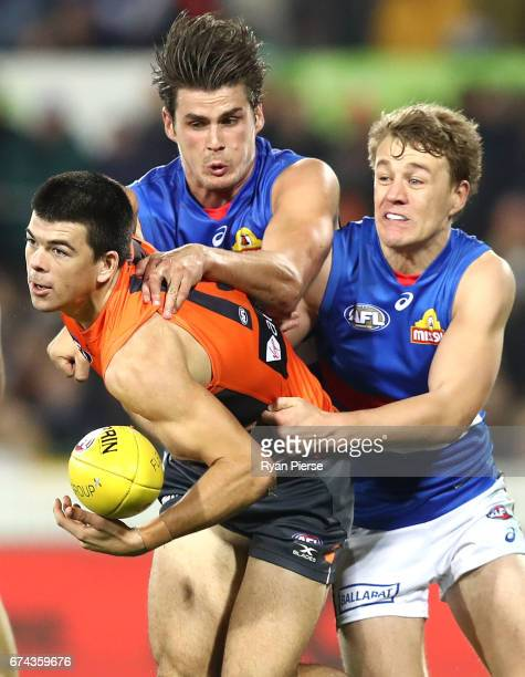 Matthew Kennedy of the Giants is tackled by Tom Boyd of the Bulldogs during the round six AFL match between the Greater Western Sydney Giants and the...