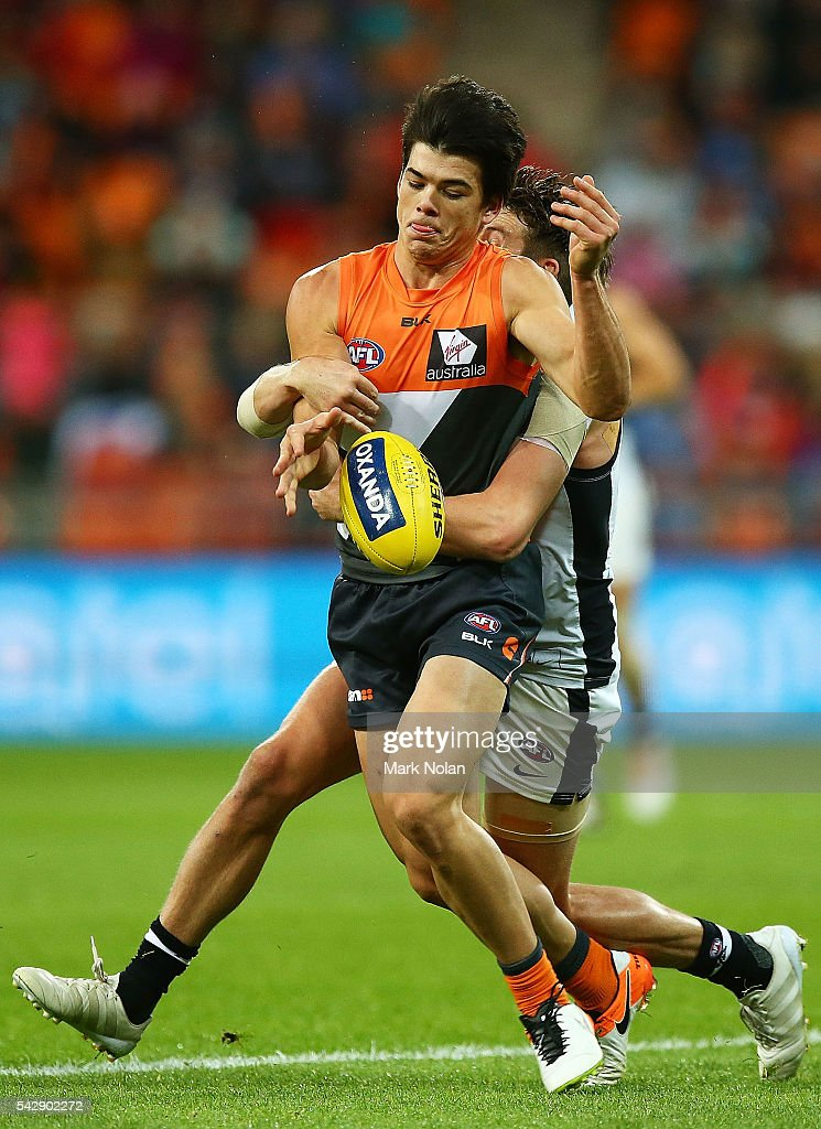 Matthew Kennedy of the Giants is tackled during the round 14 AFL match between the Greater Western Sydney Giants and the Carlton Blues at Spotless Stadium on June 25, 2016 in Sydney, Australia.