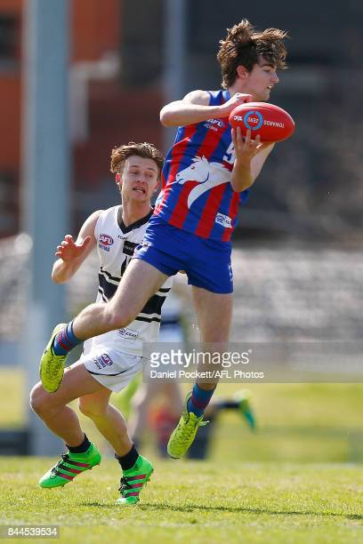 Matthew King of the Chargers handopasses the ball under pressure during the TAC Cup Final between Oakleigh and Northern Knights at Victoria Park on...