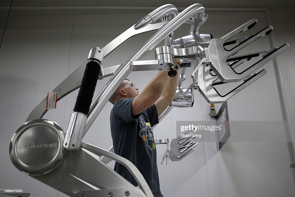 Matthew Kiser works on the tower of a Mastercraft Boat Co. inboard speed boat on the assembly line at the Mastercraft factory in Vonore, Tennessee, U.S. on Tuesday, Feb. 4, 2014. Orders for U.S. factory goods, excluding transportation, rose .2 percent in December, according to data released by the Census Bureau. Photographer: Luke Sharrett/Bloomberg via Getty Images