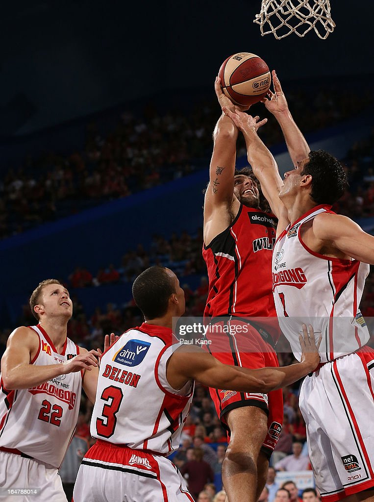 Matthew Knight of the Wildcats lays up against Oscar Forman of the Hawks during game one of the NBL Semi Final Series between the Perth Wildcats and the Wollongong Hawks at Perth Arena on March 28, 2013 in Perth, Australia.