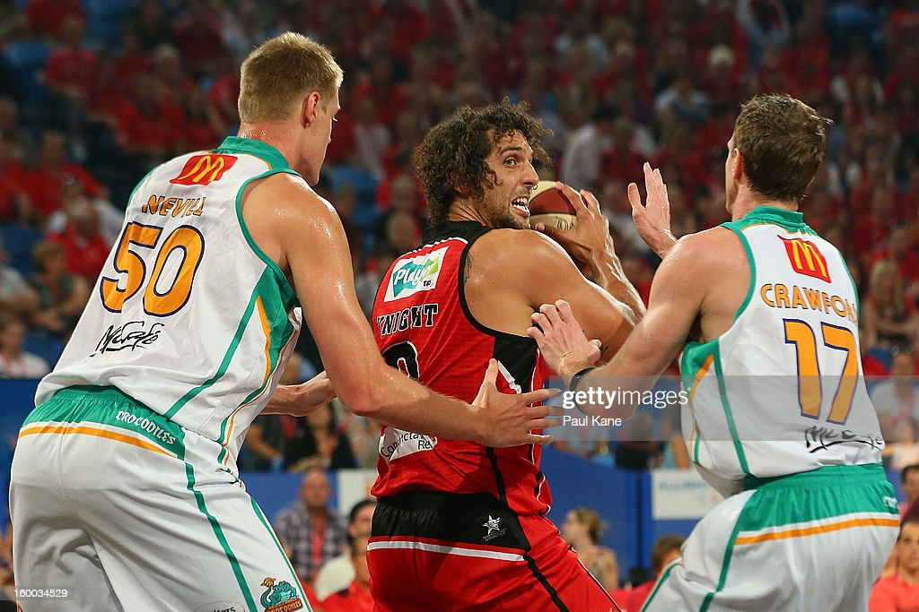 Matthew Knight of the Wildcats looks to pass against Luke Nevill and Peter Crawford of the Crocodiles during the round 16 NBL match between the Perth Wildcats and the Townsville Crocodiles at Perth Arena on January 25, 2013 in Perth, Australia.