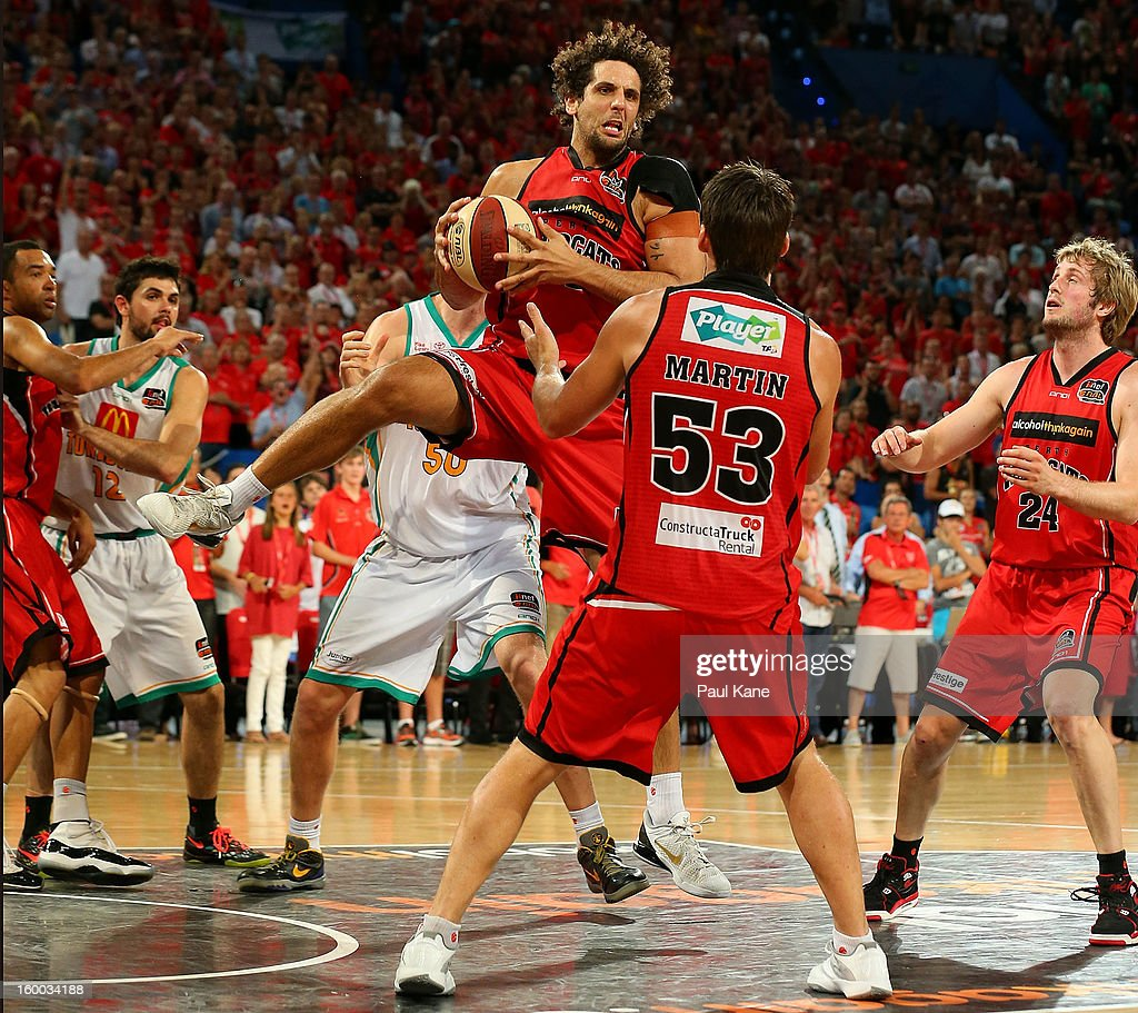 Matthew Knight of the Wildcats rebounds during the round 16 NBL match between the Perth Wildcats and the Townsville Crocodiles at Perth Arena on January 25, 2013 in Perth, Australia.