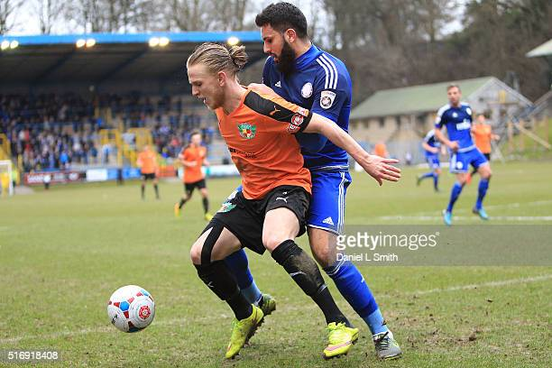 Matthew Kosylo of Nantwich Town FC holds off Hamza Bencherif of FC Halifax Town during the FA Trophy Semi Final Second Leg match between FC Halifax...