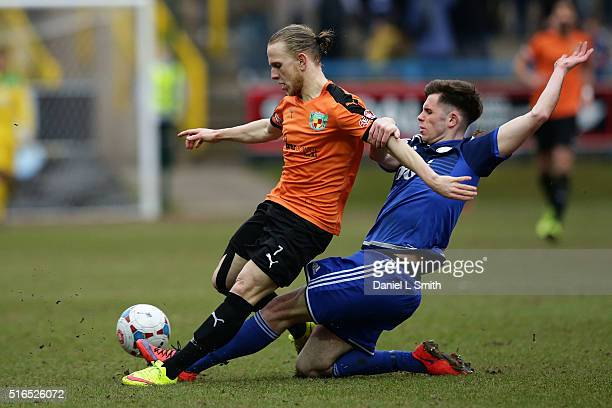 Matthew Kosylo of Nantwich Town FC is tackled by Scott McManus of FC Halifax Town during the FA Trophy Semi Final Second Leg match between FC Halifax...