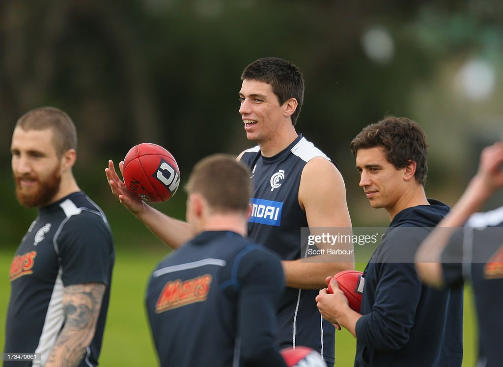 Matthew Kreuzer and Andrew Carrazzo of the Blues look on during a Carlton Blues AFL Recovery Session at St Kilda Sea Baths on July 15, 2013 in Melbourne, Australia.