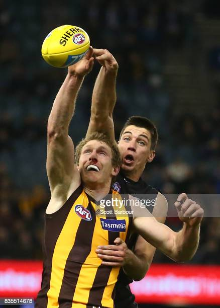 Matthew Kreuzer of the Blues and Ben McEvoy of the Hawks compete for the ball during the round 22 AFL match between the Carlton Blues and the...