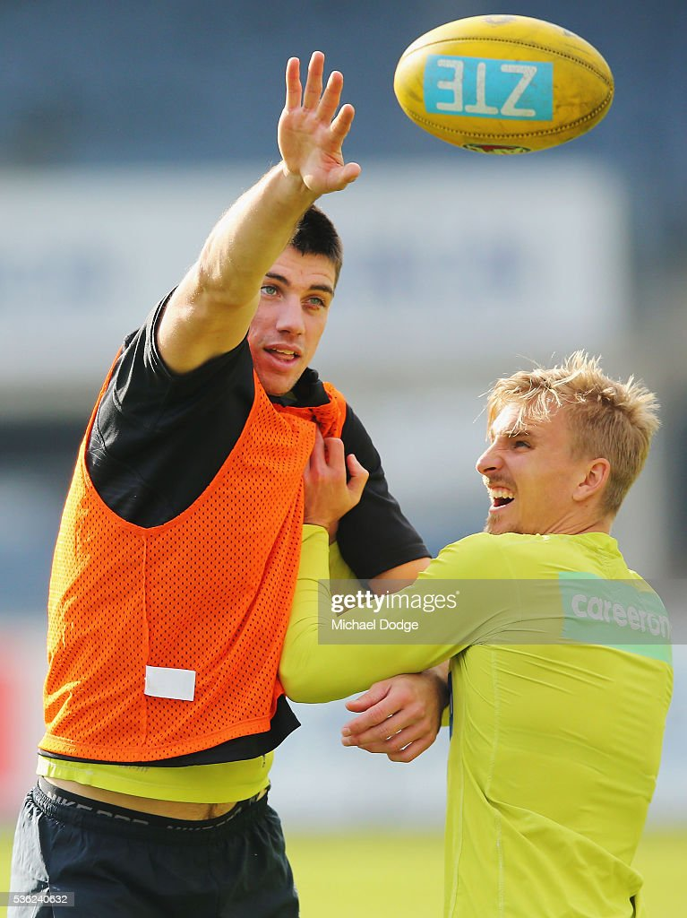Matthew Kreuzer of the Blues (L) and Dennis Armfield compete for the ball during the Carlton Blues AFL training session at Ikon Park on June 1, 2016 in Melbourne, Australia.
