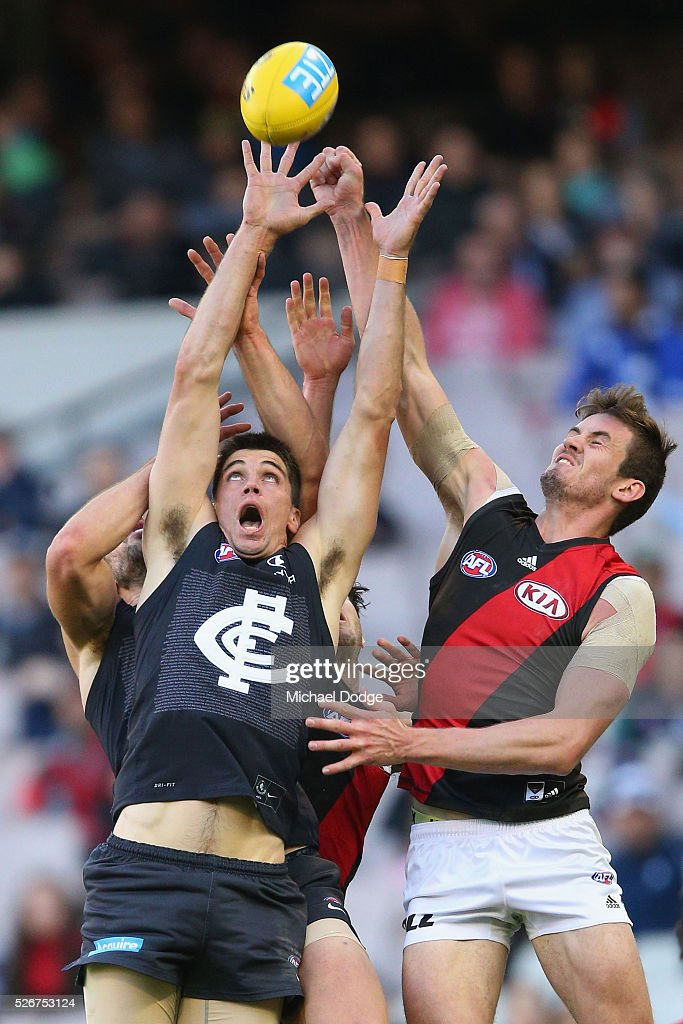 Matthew Kreuzer of the Blues (L) and Michael Hartley of the Bombers compete for the ball during the round six AFL match between the Carlton Blues and the Essendon Bombers at Melbourne Cricket Ground on May 1, 2016 in Melbourne, Australia.