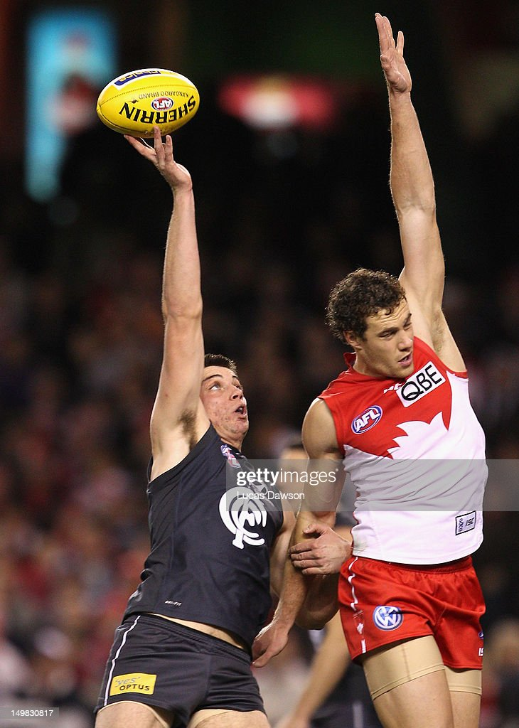 Matthew Kreuzer of the Blues and Shane Mumford of the Swans contest in the ruck during the round 19 AFL match between the Carlton Blues and the Sydney Swans at Etihad Stadium on August 5, 2012 in Melbourne, Australia.
