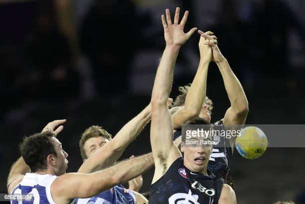 Matthew Kreuzer of the Blues and Todd Goldstein of the Kangaroos compete for the ball during the round 10 AFL match between the Carlton Blues and the...
