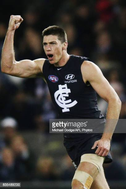 Matthew Kreuzer of the Blues celebrates a goal during the round 22 AFL match between the Carlton Blues and the Hawthorn Hawks at Etihad Stadium on...