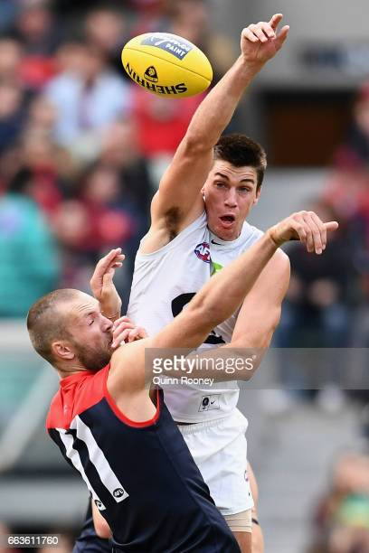 Matthew Kreuzer of the Blues competes in the ruck against Max Gawn of the Demons during the round two AFL match between the Melbourne Demons and the...