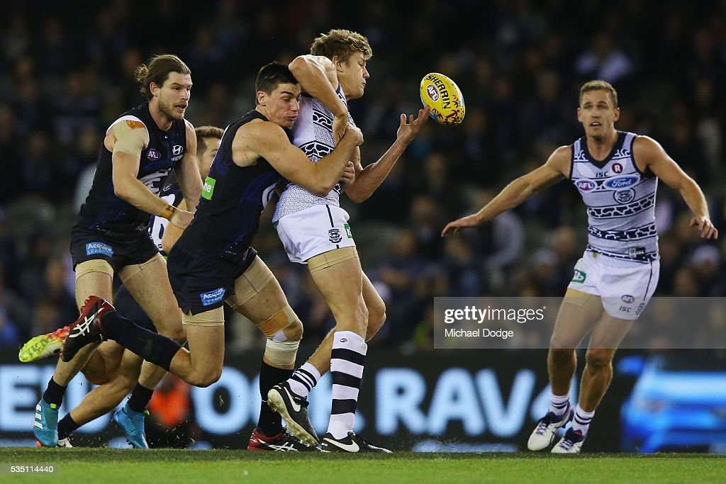 Matthew Kreuzer of the Blues tackles Rhys Stanley of the Cats during the round 10 AFL match between the Carlton Blues and the Geelong Cats at Etihad Stadium on May 29, 2016 in Melbourne, Australia.